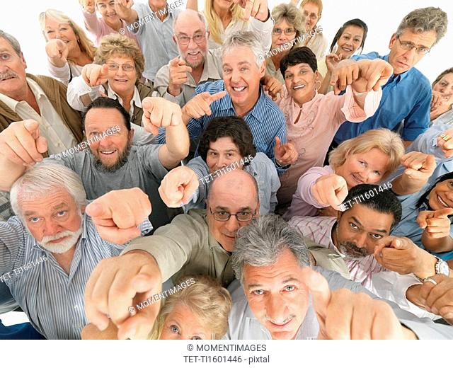 A group of people pointing up