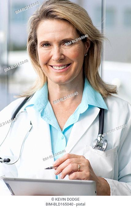 Close up of Caucasian doctor using digital tablet