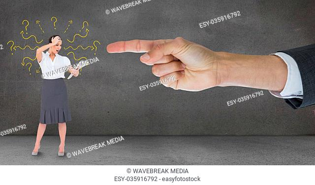Hand pointing at surprised business woman against grey background with question marks