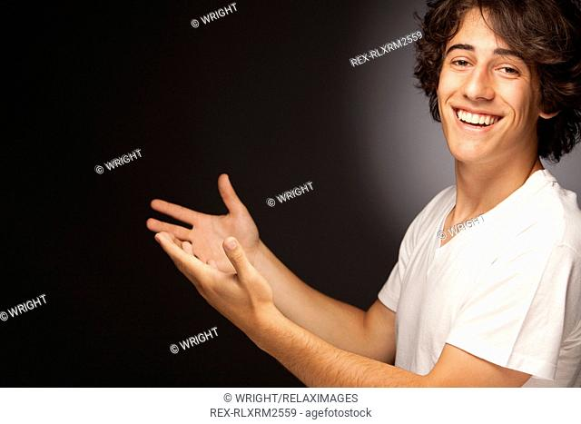 Teenager male portrait smiling friendly gesture