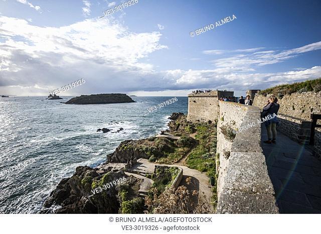 Tourists near Tower Bidouane in Saint-Malo (Bretagne, France)