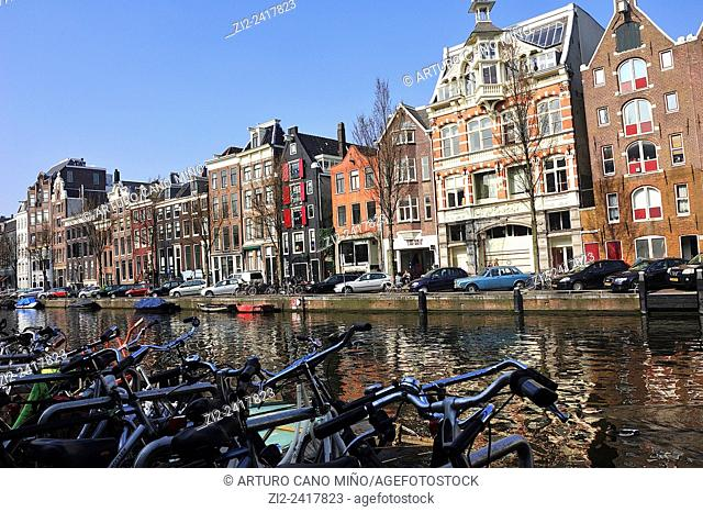 Old houses at side of a canal. Amsterdam, The Netherlands