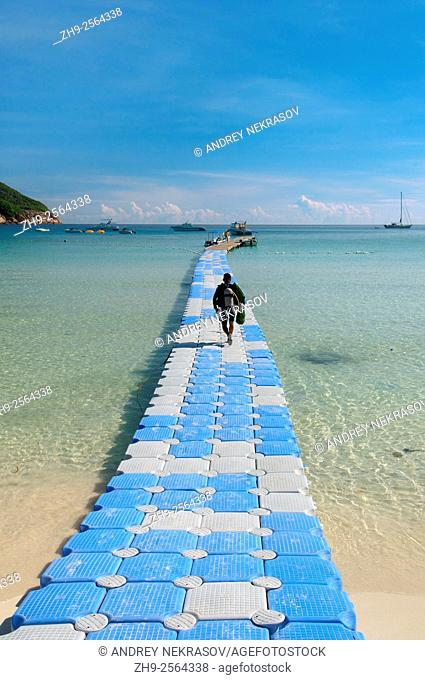 The diver is on a floating pier for diving boat, Redang Island, Malaysia, Asia