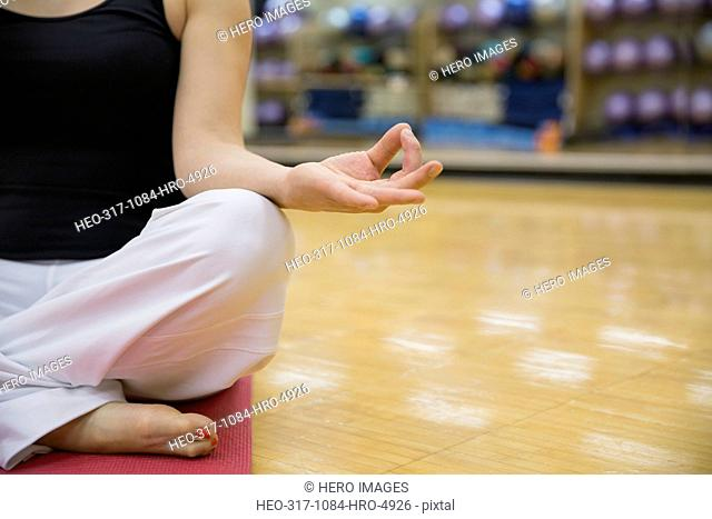 Close up of woman in lotus position