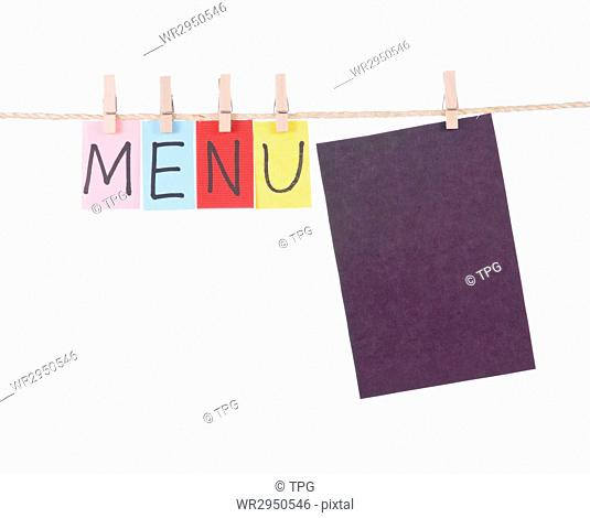 Menu, Colorful words hang on rope by wooden peg
