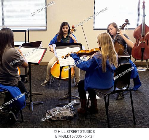 Students rehearsing in middle school band class
