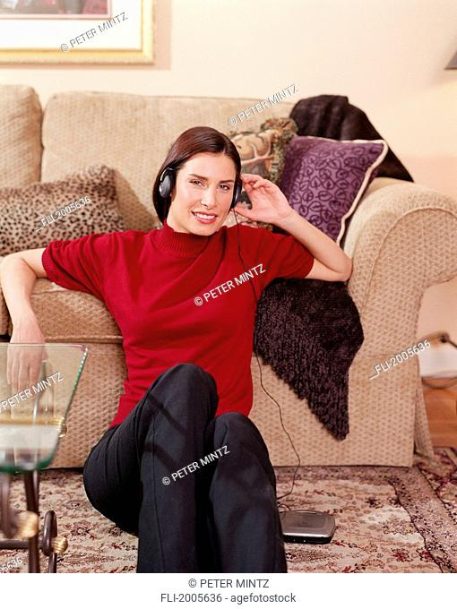Fv5444, Peter Mintz; Woman Leaning Against Couch With Headphones