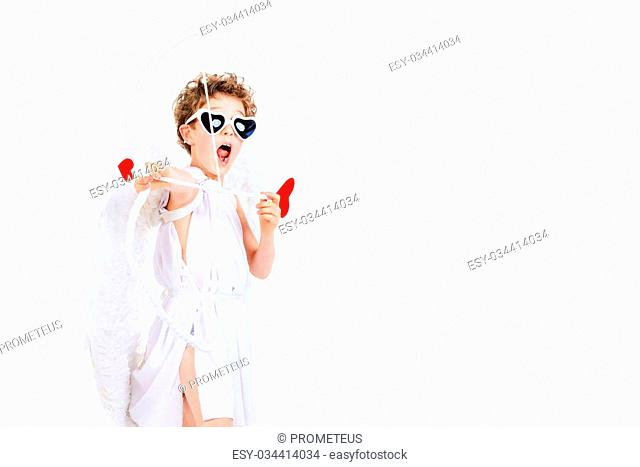 Lovely emotional little boy in a costume of angel. Cupid with a bow and arrows of love. Valentine's day. Isolated over white
