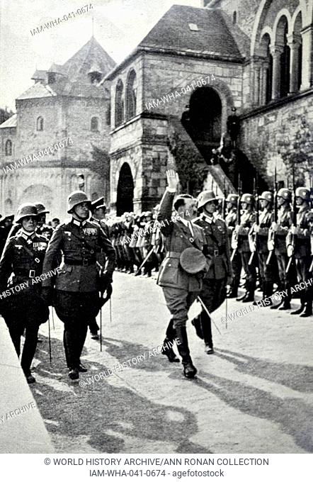 Adolf Hitler with an honour guard in 1934