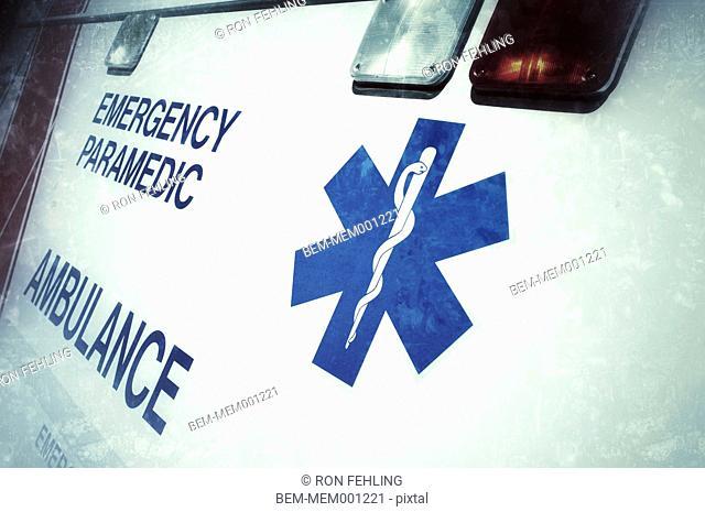 Close up of caduceus on ambulance