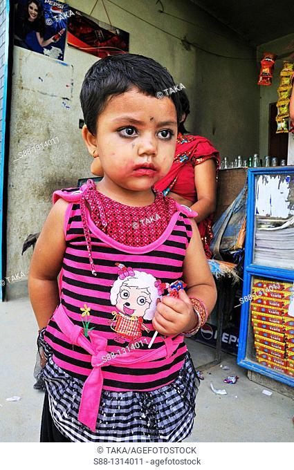 Little girl wear pink shirt at the little sweet shop