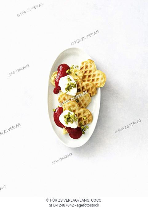 Sweet lupine waffles with raspberry sauce and cream