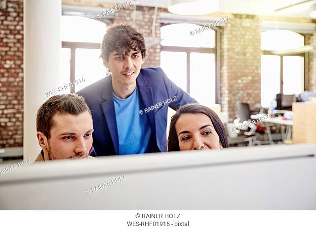 Creative team working together , using computer