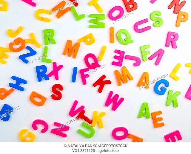 multicolored English alphabet letters on a white background, full frame