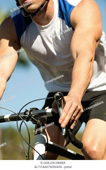Man riding bicycle, mid section