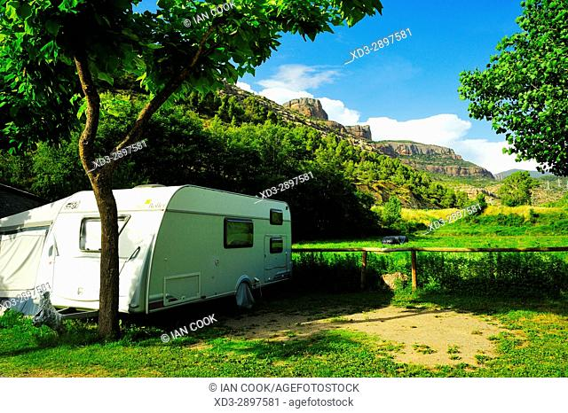 caravan and view of Pyrenees Mountains from Camping Collegats, La Pobla de Segur, Llieda Province, Catalonia, Spain