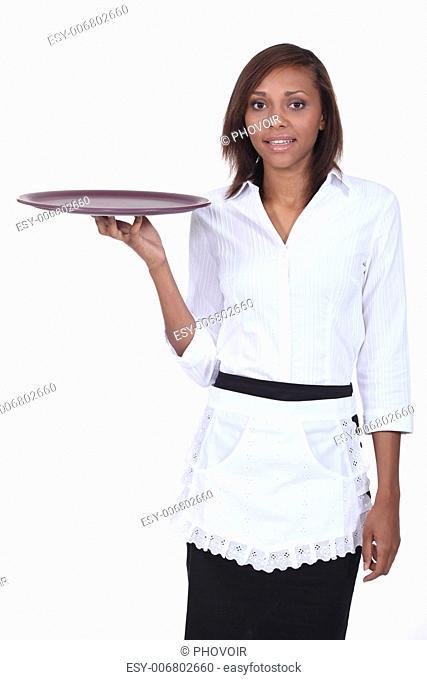 Waitress holding empty tray