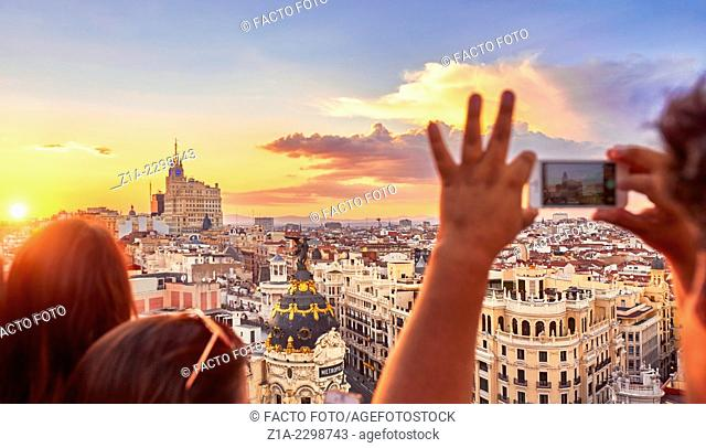 People watching the sunset from The Circulo de Bellas artes cultural center rooftop terrace. Madrid. Spain