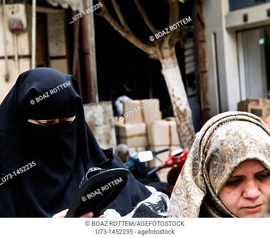 Women wearing a Burqa and a Hijab