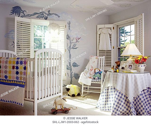 CHILDREN'S BEDROOM: White crib, white trim, white wooden shutters at windows, around table. Mural of Jack and the bean stalk frame window