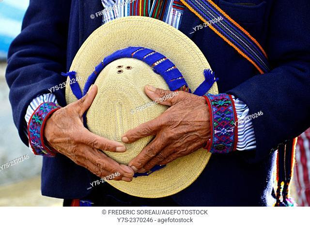 Hands holding hat, Todos Santos Cuchumatan, Guatemala, Central America
