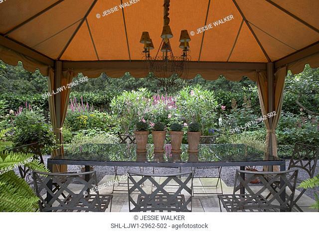 GAZEBOS: Garden, patio, fabric gazebo, chandelier, rectangular dining table , boston ferns garden surrounds, horizontal facing flower beds