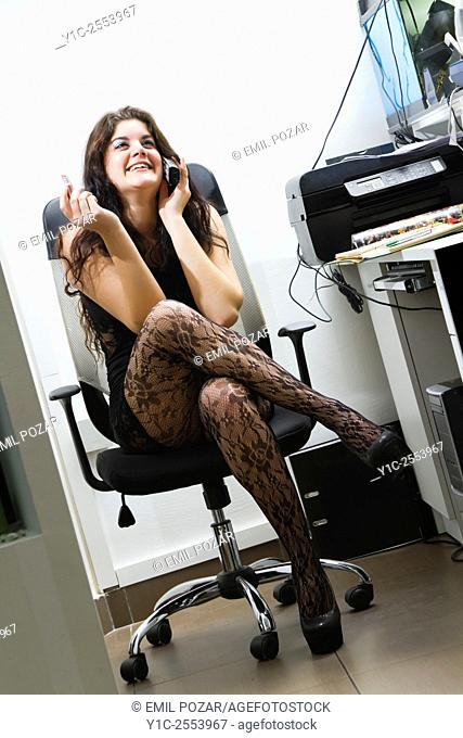 Young female secretary bad at work