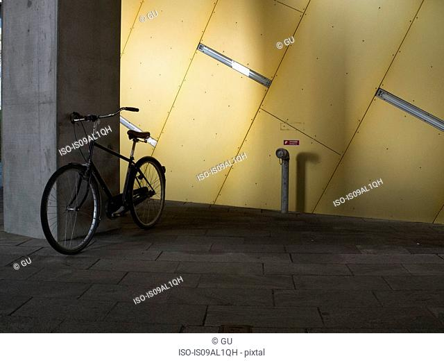 Parked bicycle in 8 House, Copenhagen, Denmark