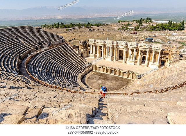 People visit The ruins of Antique Theater in ancient Greek city Hierapolis, Pamukkale, Turkey. 25 August 2017