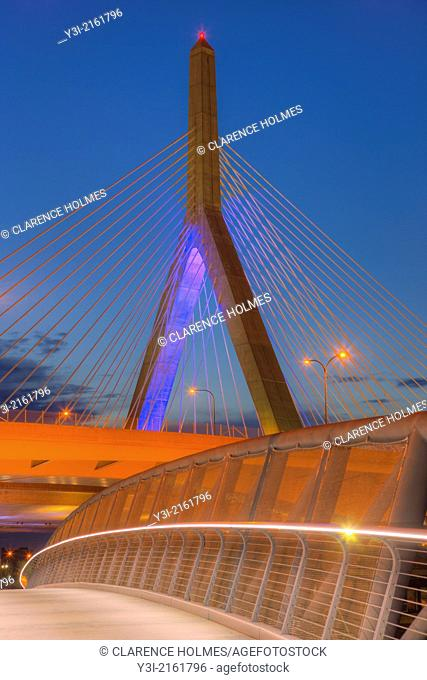 The sky begins to lighten during morning twilight behind one of the suspension towers of the Leonard P. Zakim Bunker Hill Memorial Bridge