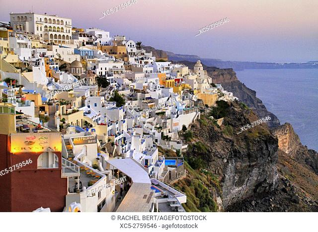 Fira, view of the city across collapsed caldera at dusk, Santorini/Thera island, Greece
