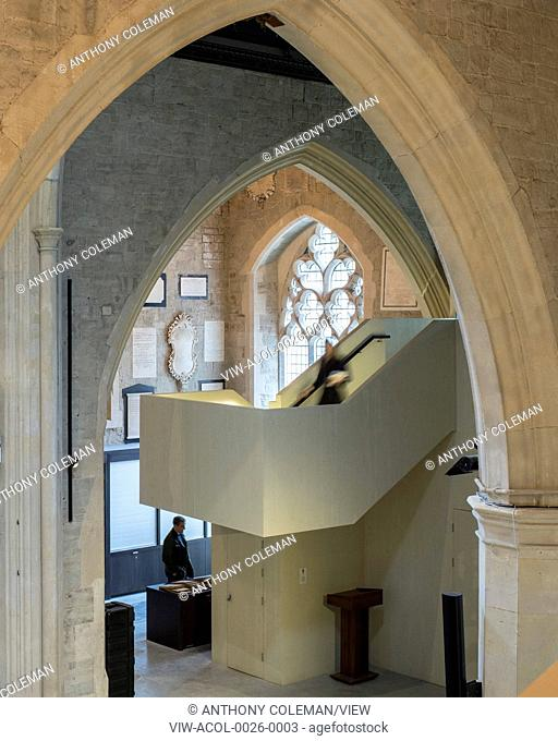 View through arch with stairway and ground floor exhibition space. Garden Museum Lambeth Palace, London, United Kingdom. Architect: Dow Jones Architects, 2017