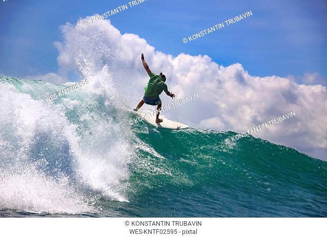 Indonesia, Bali, Kuta, surfer falling