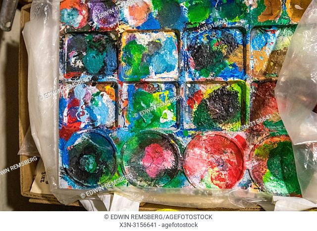 Layers of colorful paint cover a palette