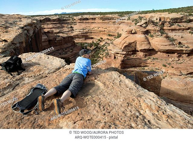Woman at Moon House ruins, Cedar Mesa, Bears Ears National Monument, Utah, USA