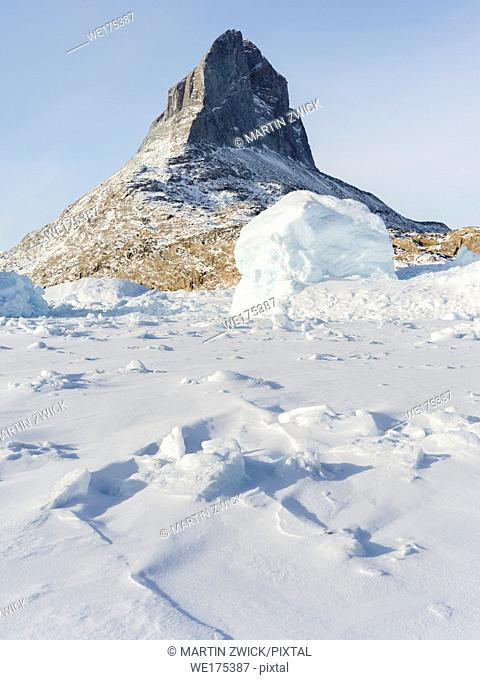Icebergs frozen into the sea ice of the Uummannaq Fjordsystem during winter in the northwest of greenland north of the polar circle near Ikerasak