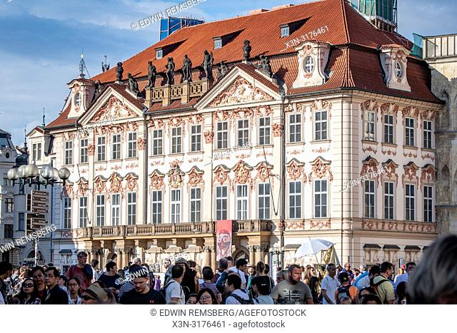 Distant view of Art Deco style building with crowds in foreground, Prague - Czech Republic