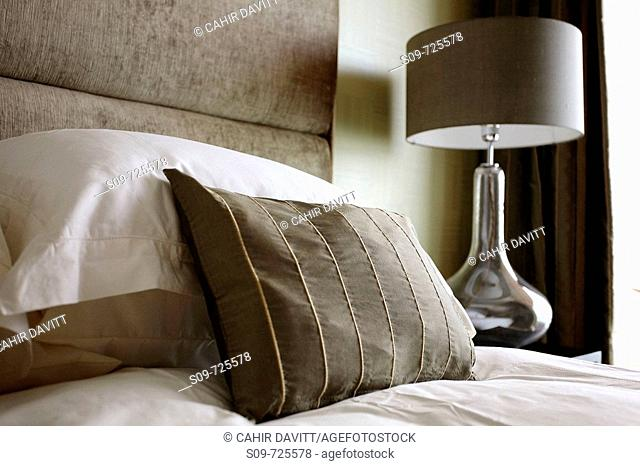 Bedspread, embroidered pillow and table lamp, Bridgewater Apartments, North Quay, Arklow, Co  Wicklow, Ireland