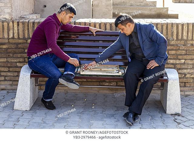 Two Uzbek Men Playing Board Games In The Street, Khiva, Uzbekistan