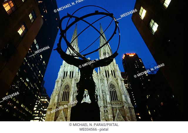 5th Avenue, statue of Atlas and cathedral of Saint Patrick. New York City, USA