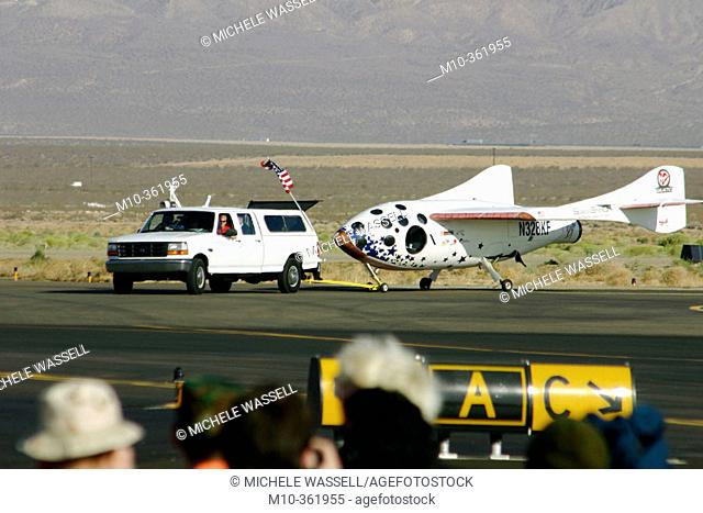 Ansari XPrize 1st Flight for SpaceShipOne: White Knight and SS1 taxing out to take off. After a successful flight, the vehicle is pulling SS1 over to the crowd