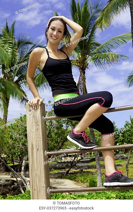 young woman exercising in hawaii