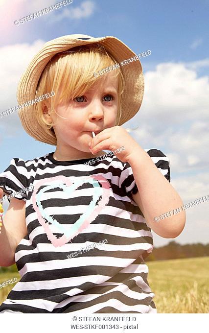 Portrait of little girl with lollipop