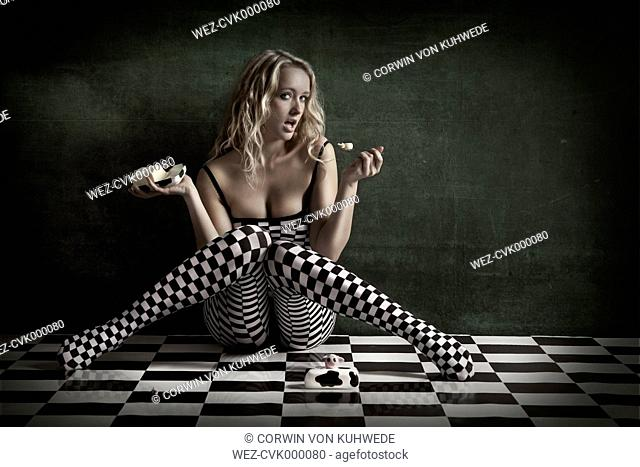 Blond young woman wearing checkered tights
