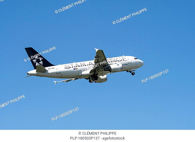 Airbus A319-112, narrow-body, commercial passenger twin-engine jet airliner from Belgian Brussels Airlines in flight against blue sky