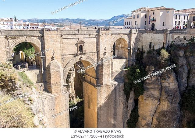 New Bridge over Guadalevin River in Ronda, Malaga, Spain. Popular landmark in the evening