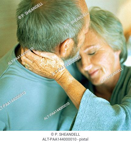 Mature couple hugging