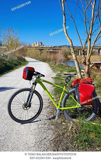 cycling tourism MTB bike in Ribarroja Parc de Turia with paniers and saddlebag