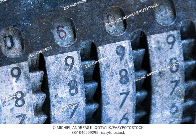 Vintage manual adding machine isolated on white, selective focus - 600
