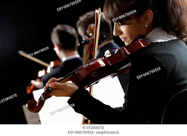 Violinist woman playing a concert of classical music